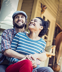 young couple laughing on porch